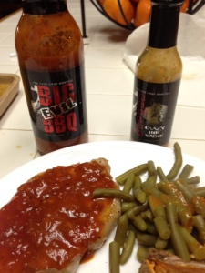 "An ""Evil"" meal of pork tenderloin and green beans with Big Evil BBQ and Asylum Hot Sauce for the beans!"